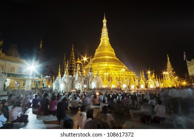 YANGON, MYANMAR - FEBRUARY 18:  People gather around the Schwedagon Pagoda on February 18, 2011 in Myanmar to pray and pay homage to the most revered pagoda in Yangon