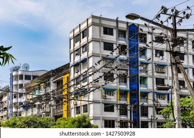 YANGON, MYANMAR - FEBRUARY 21, 2013: Cable jungle and street architecture in the colonial city of Yangon, Myanmar