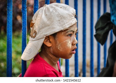 YANGON, MYANMAR - FEBRUARY 22, 2013: Local boy with thanaka in the colonial city of Yangon, Myanmar