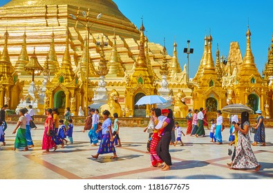 YANGON, MYANMAR - FEBRUARY 27, 2018: The beautiful architecture of Shwedagon Zedi Daw - the most sacred Buddhist pagoda in country, full of pilgrims and tourists, on February 27 in Yangon.