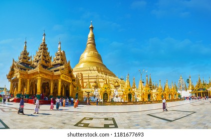 YANGON, MYANMAR - FEBRUARY 27, 2018: Giant golden stupa of Shwedagon Zedi Daw temple - most sacred Buddhist complex in country, famous for its architecture and rich decors, on February 27 in Yangon