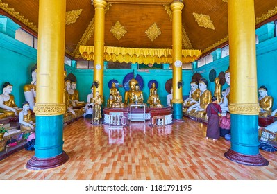 YANGON, MYANMAR - FEBRUARY 27, 2018: The golden statues of Lord Buddha in the Image House, located next to the Naung Daw Gyi Pagoda of Shwedagon Zedi Daw complex, on February 27 in Yangon.