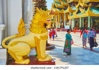 YANGON, MYANMAR - FEBRUARY 27, 2018: The golden statue of chinthe (leogryph) guards the entrance to the Image House of Shwedagon Zedi Daw, on February 27 in Yangon.