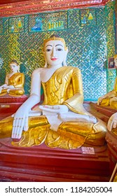 YANGON, MYANMAR - FEBRUARY 27, 2018:  The image of Buddha Touching Earth in Shrine of Footprint of Shwedagon Zedi Daw, decorated with complex glass pattern on walls, on February 27 in Yangon