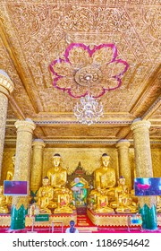 YANGON, MYANMAR - FEBRUARY 27, 2018:   The altar of Kassapa Buddha Image House of Shwedagon Zedi Daw with numerous golden images, scenic columns and carved decors, on February 27 in Yangon