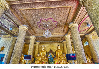 YANGON, MYANMAR - FEBRUARY 27, 2018:  Outstanding interior of Kassapa Buddha Image House of Shwedagon Zedi Daw with fine carved patterns on ceiling, walls and columns, on February 27 in Yangon