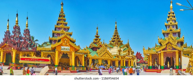 YANGON, MYANMAR - FEBRUARY 27, 2018: Panorama with pyatthat roofs of Rakhine Tazaung, Daw Pwint Tazaung, Koo Chein Kan and Ma Kyee Kyee Hall, Kassapa Image House of Shwedagon, on February 27 in Yangon