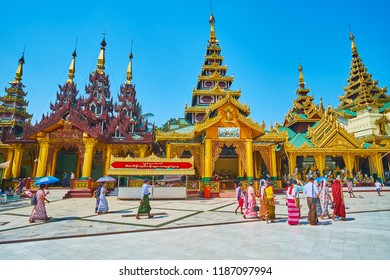 YANGON, MYANMAR - FEBRUARY 27, 2018: The ornate shrines on Western side of Shwedagon Pagoda - Rakhine Tazaung, Daw Pwint Tazaung, Koo Chein Kan and Ma Kyee Kyee Hall, on February 27 in Yangon