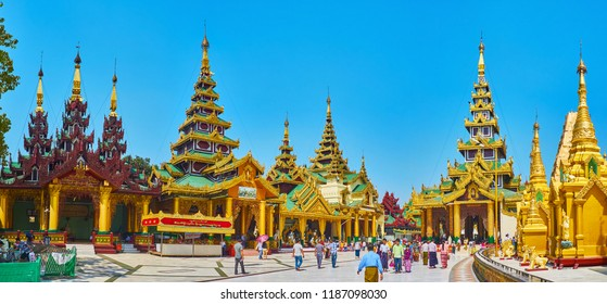 YANGON, MYANMAR - FEBRUARY 27, 2018: Panorama of Western shrines of Shwedagon Pagoda with unique Burmese architecture of Rakhine Tazaung, Daw Pwint Tazaung and Kassapa Shrine, on February 27 in Yangon