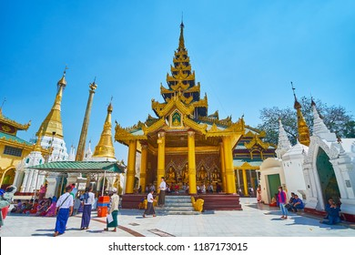 YANGON, MYANMAR - FEBRUARY 27, 2018:  The scenic Image House with gilt interior in the middle of circle alley of Shwedagon Zedi Daw, on February 27 in Yangon