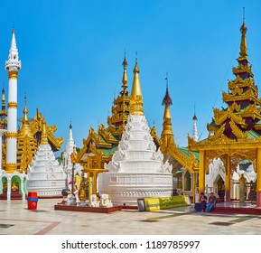 YANGON, MYANMAR - FEBRUARY 27, 2018: The picturesque white stupa with carved stucco patterns is the replica of hti umbrella (upper part of pagoda) in Shwedagon Zedi Daw, on February 27 in Yangon.