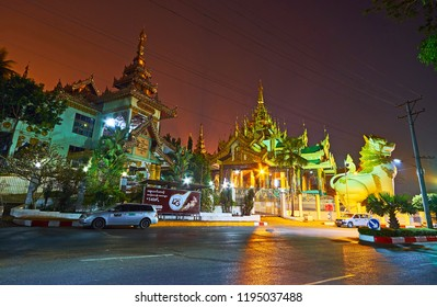 YANGON, MYANMAR - FEBRUARY 27, 2018: The great statues of chinthe (leogryphs) at the North Gate of Shwedagon Zedi Daw, on February 27 in Yangon.