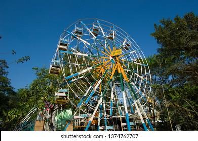 YANGON, MYANMAR - FEBURARY 27 2015:  The abandoned amusement park in downtown Yangon.