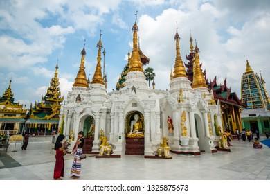 Yangon, Myanmar - January, 12, 2019: Buildings, Buddha Imagens and People in Shwedagon Pagoda Temple.