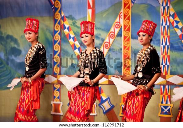 YANGON, MYANMAR - JANUARY 25: Unidentified dancers perform traditional classical Kachin dance in honor of Karen New Year on January 25, 2011 in Yangon, Myanmar