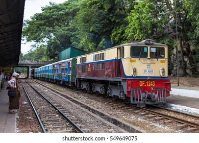 YANGON, MYANMAR - JANUARY 3, 2017 : Passengers getting off the local circle train in Yangon. Yangon Circular Railway is the local rail network that serves the Yangon metropolitan area.