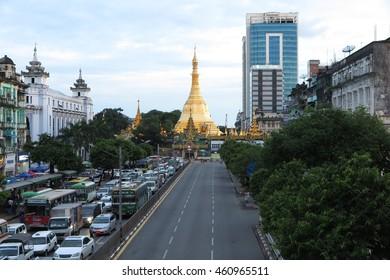 YANGON, MYANMAR - JULY 22, 2016 : Sule Pagoda in evening in downtown, Yangon, Myanmar. Sule Pagoda located in the heart of Yangon.