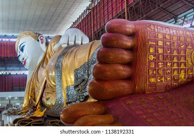 YANGON, MYANMAR - JULY 29, 2016: Buddha footprint of Reclining Buddha image containing the 108 marks. Chaukhtatgyi Buddha Temple. Landmark and popular for tourist attractions in Yangon. Myanmar. Asia.