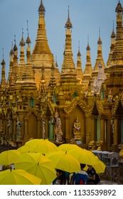 Yangon, Myanmar, June 2017: Umbrellas in the rain at the Shwedagon Temple, Yangon, Myanmar