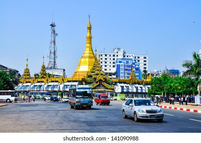YANGON, MYANMAR - MAR 19: Traffic in downtown Yangon on Mar 19, 2013, in Yangon, Myanmar (or Burma). In the middle of a roundabout, stands the Sule Pagoda, a religious and historic site.