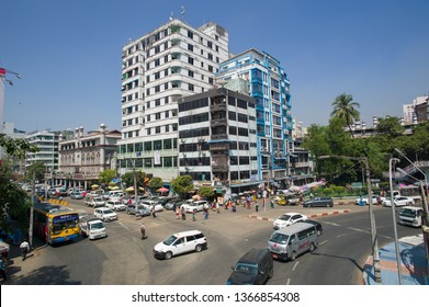 YANGON, MYANMAR, MAR 6: The busy traffic in old town Yangon, Myanmar on March 6 2015. Public bus is the major transportation in the city.