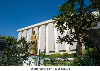 Yangon, Myanmar - March 1 2015: The statue of Statue of King Anawratha and the exterior of National Museum of Myanmar.