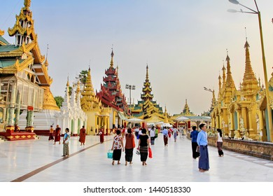 YANGON, MYANMAR - MAY 21, 2019: Atmosphere inside the temple at Shwedagon pagoda (1 of 5 sacred places) is pagoda that symbolize the spiritual and famous tourist attraction in Yangon, Myanmar