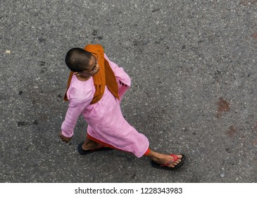 Yangon, Myanmar -  Nov 01 2017: Woman-monk walking, view from the top