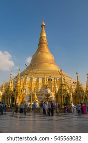 YANGON, MYANMAR - NOVEMBER 26, 2016: people and monks at the sunset  in the Shwedagon pagoda. The Shwedagon pagoda is the most famous pagoda of south est Asia