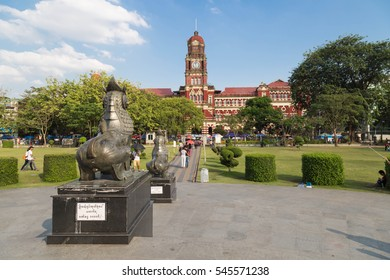 YANGON, MYANMAR - NOVEMBER 26, 2016: The red building of High Court Palace  is listed on the Yangon Heritage List. It is located near the City Hall, the Independence Monument and the Maha Bandula Park
