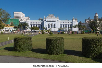 YANGON, MYANMAR - NOVEMBER 27, 2016: The withe palace of Yangon City Hall is centrally located  and it has been the focal point of several major political demonstrations.