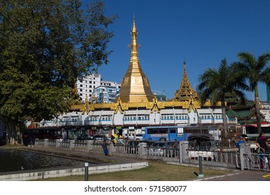 YANGON, MYANMAR - NOVEMBER 27, 2016: some cars and traffic in the downtown of Yangon, Myanmar, with the Sule pagoda in the background
