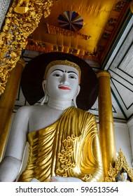 Yangon, Myanmar - Oct 1, 2011. Golden Buddha statue at main hall in Shwedagon Paya in Yangon, Myanmar. Shwedagon Pagoda is the most sacred Buddhist pagoda in Myanmar.