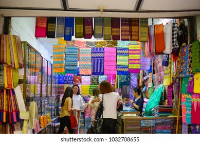 Yangon, Myanmar - October 12, 2016 : Myanmar Sarong shop in market, colorful sarong available in small shop and sell by small business owner