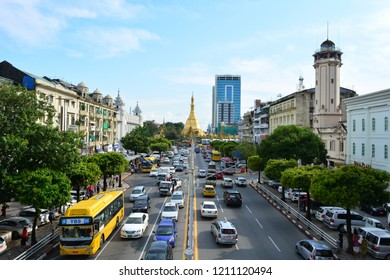 YANGON, MYANMAR - OUT 9TH, 2018: Street of Yangon and the Sula Pagoda at the background, in Yangon, Myanmar, on Out 9th, 2018