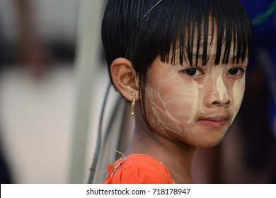 YANGON, MYANMAR - SEPTEMBER 03, 2017: UNIDENTIFIED YOUNG MYANMAR GIRL WITH TANAKA PASTE ON HER FACE