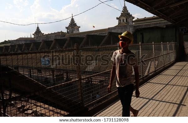 Yangon railway station,Myanmar(Burma)-May14,2020, Construction worker Walking at train station