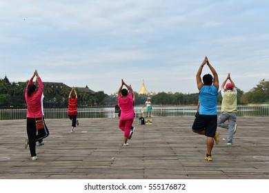 Yangon,Myanmar : December 16,2016 - local burma people are exercising in Kandawgyi Lake in early morning ,Yangon Myanmar