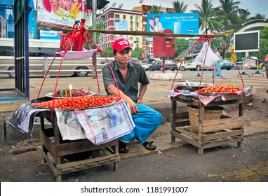 YANGON/MYANMAR - SEP 14. Unidentified local man sales fresh vegetables in the city street on September 14, 2018 in Yangon (Rangoon, Rangun), Myanmar (Burma), Southeast Asia