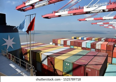 Yangshan, Shanghai / China - September 24 2019: Large cargo container ship owned by Maersk Line during cargo operations in the port of Yangshan.
