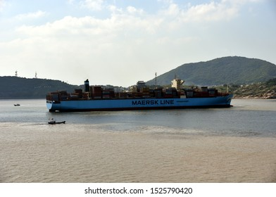Yangshan, Shanghai / China - September 24 2019: Large cargo container ship owned by Maersk Line, arriving to the port of Yangshan, China.