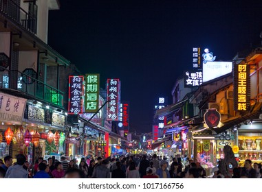 YANGSHOU CHINA - NOVEMBER 9, 2017: Unidentified people visit West street. West street is a main commercial street with restaurants bars and gift shops.