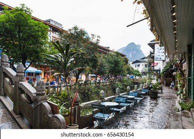 YANGSHUO, CHINA - MARCH 30, 2017: waterfront in Yangshuo town in spring. Town is resort destination for domestic and foreign tourists because of scenic karst peaks