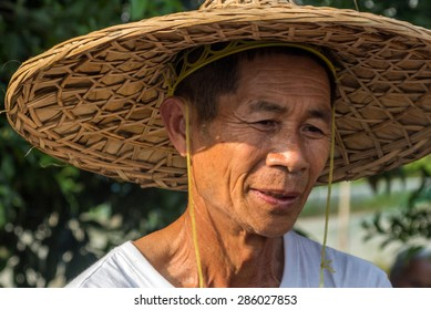 YANGSHUO, CHINA - MAY 01, 2015: An unidentified old farmer in Yangshuo, China.  Agriculture is a vital industry in China, employing over 300 million farmers.