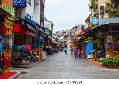 YANGSHUO, GUILIN, GUANGXI/CHINA-OCT 13: West street on Oct 13, 2015 in Yangshuo, Guilin, Guangxi, China. Yanghshuo is a city surrounded by many karst mountains and beautiful scenery near Guilin.