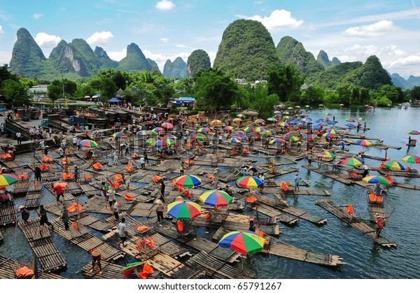 YANGSHUO - OCTOBER 1: masses of people spend their National Day holiday on October 1, 2010 in Yangshuo, China. A popular activity is bamboo rafting here in Yangshuo.