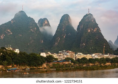 Yangshuo town in China with beautiful karst mountains.