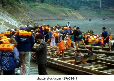 YANGTZE RIVER, CHINA - CIRCA OCT 2001 : Tourists ready to board river boats, circa October 1002 at Yangtze River, China.