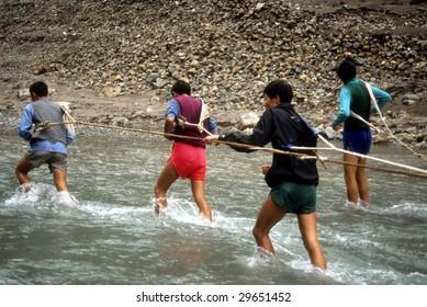 YANGTZE RIVER, CHINA - CIRCA OCT 2001:  Boat porters pull boats in shallow water, circa October 1002 at Yangtze River, China.