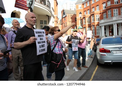 Yanis Varoufakis supports the free Julian Assange vigil outside the Ecuadorian Embassy, 'Blowing the whistle on war crime is not a crime'.
